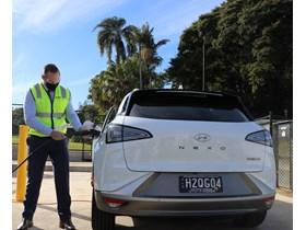 Hydrogen Minister Mick de Brenni refuels one of the new record-setting hydrogen-powered Hyundai Nexo vehicles