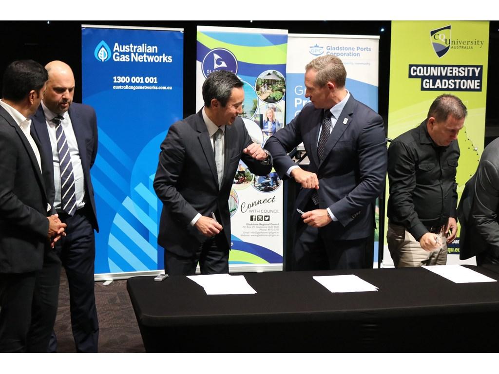 Energy Minister Mick de Brenni congratulates Sumitomo Corporation's Yoshikazu Ishikawa in Gladstone.