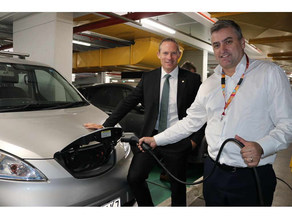 Minister for Energy, Renewables and Hydrogen Mick de Brenni with Logan MP and proud EV owner Linus Power with the new chargers.