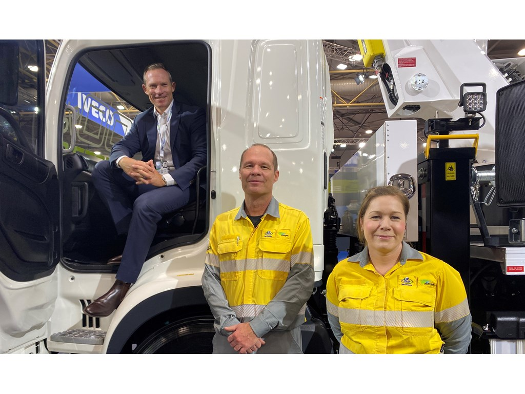 Energy Minister Mick de Brenni checks out Queensland's first fully electric bucket truck with Energex Area Manager Trevor King and Fleet Manager Sonia Gollschewski at the Brisbane Truck Show.