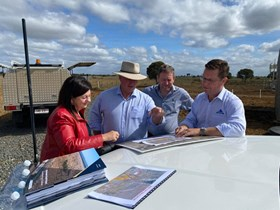 Isaac Mayor Anne Baker, Resources Minister Scott Stewart, Isaac Regional Council CEO Jeff Stewart-Harris, and Whitehaven Coal Project Director Todd Harrington survey the site of the proposed mine